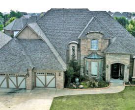 Residential roofing with Malarkey Legacy IR shingles in Natural Wood done by Yates Roofing and Construction in OKC