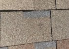 Hail damaged shingle found by Yates Roofing and Construction in Yukon